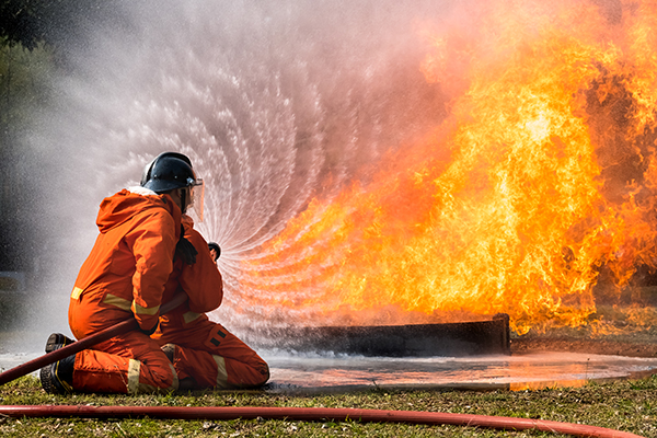 Firefighter splash water to fire hydrant